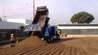 End dump truck unloading dirt