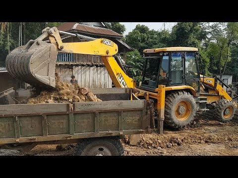 JCB Dozer Loading Stone and Mud in Tractor - JCB - Roadplanet Dozer Video