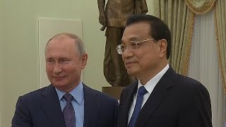 Russian President Putin meets with Chinese Premier Li at the Kremlin
