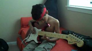 9 year old guitar player trying Santana Black Magic Woman Solo #1