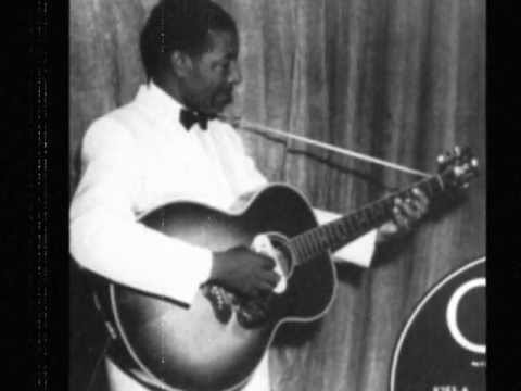 Lonnie Johnson (1899-1970) playing with the strings, 1928.