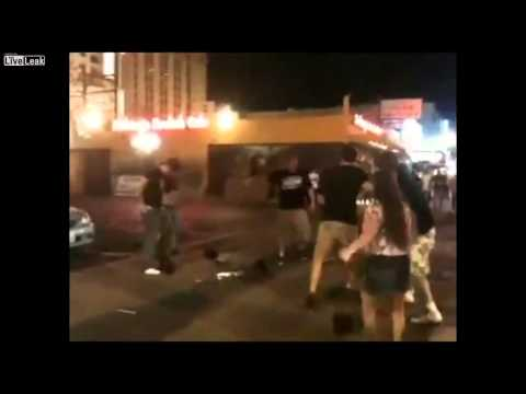 Brutal street fight in Las Vegas bunch of crazy guys brawling
