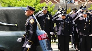 Thousands turn out for officer Brian Moore's funeral