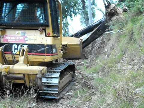 CAT D4 DOZER clearing  trees off bush tracks