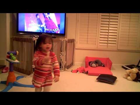 Mia Studying dance moves and Karaoke