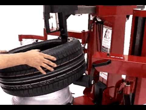tire changers - coats 9024e rim clamp tire changer servicing a bridgestone  runflat
