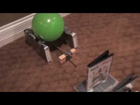 how to build a simple machine to pop a balloon