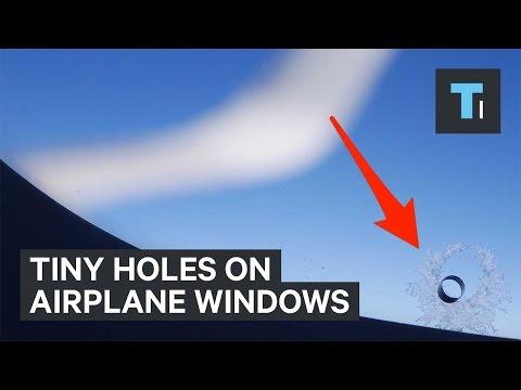 Tiny holes on airplane windows