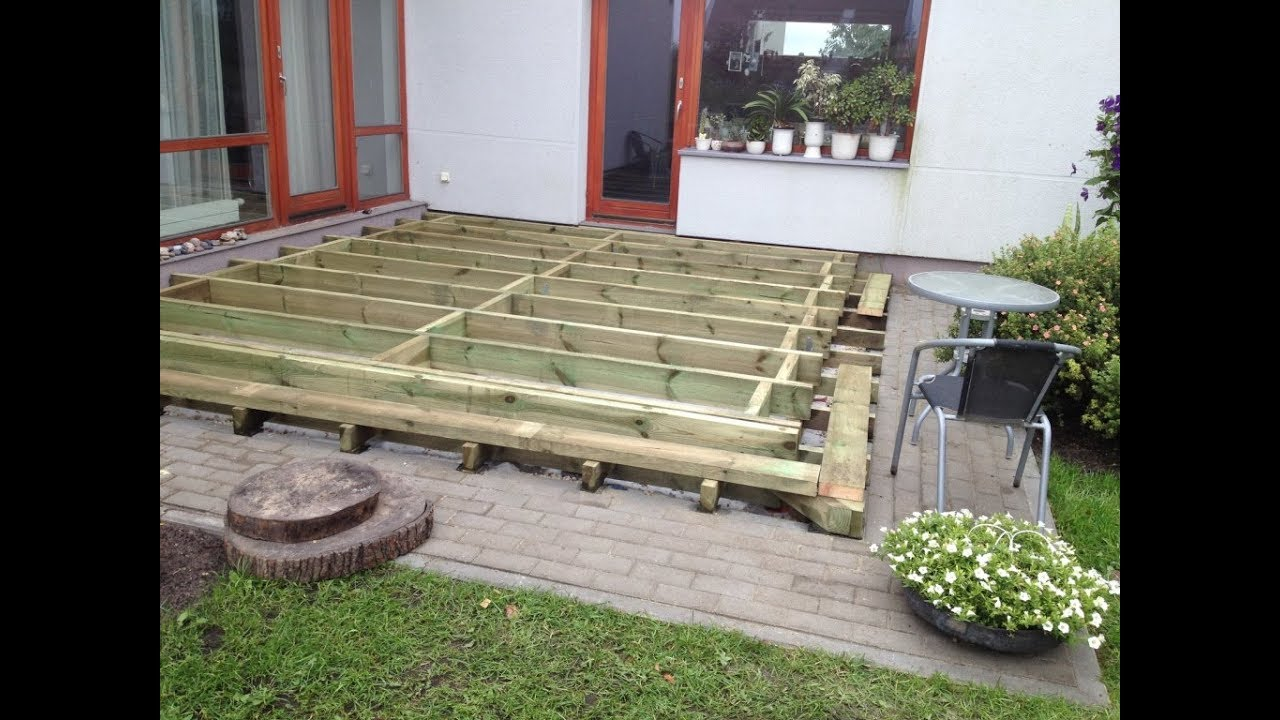 How to Build a Ground Level Deck - frame - ( Part 1) - YouTube
