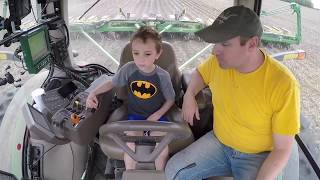 Farm Kid Drives Planter Tractor