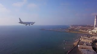Guy with brain piercing films landing airplanes with Mavic from 86 meters at Tel Aviv Airport