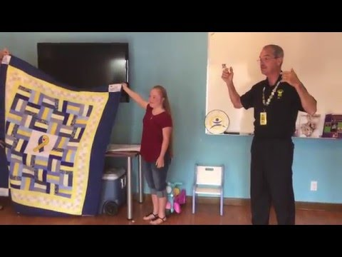 Surprise Quilt Delivery to Retiring Director of Down Syndrome Society of Central Florida