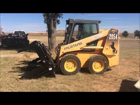 Job Site Clean Up With The Mustang 2054 Skid Loader And Titan Rock Bucket Grapple