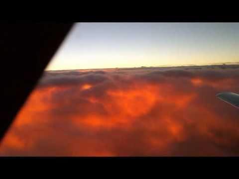 Sun rise under the clouds at FL280