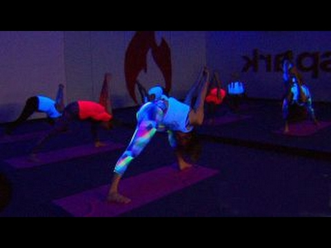 New fitness trend brings party atmosphere to yoga practice