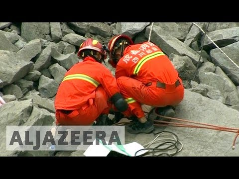 Thumbnail: Scores missing as search for China landslide survivors continues