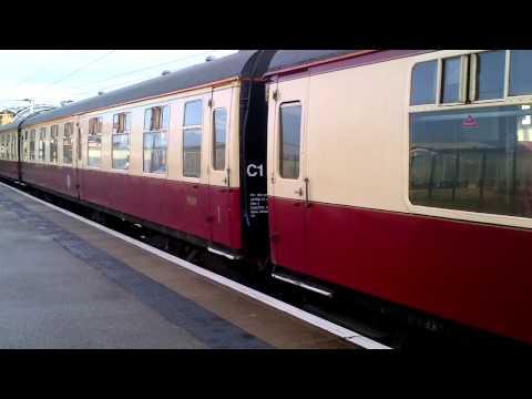 90019 leaving  york station to take charter stock to sidings  07/12/2013