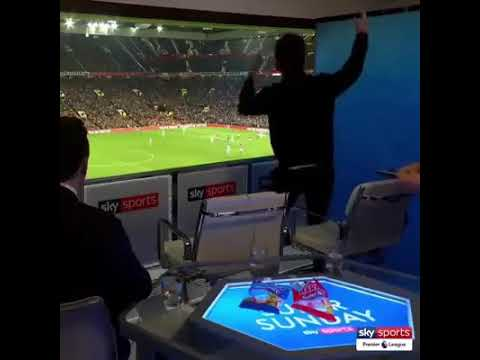 Noel gallagher and Gary Neville watching man utd vs man city