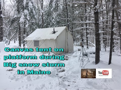 Canvas Tent on platform during snow storm in Maine