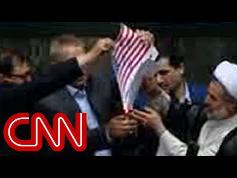 Iranian lawmakers burn American flag after US leaves deal