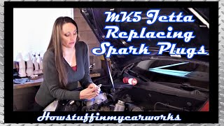 Pretty Brunette Replaces Spark Plugs and Air Filter on MK5 2.5 L 5 Cyl. VW Jetta