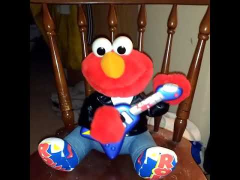 Rock and Roll Elmo performing a song
