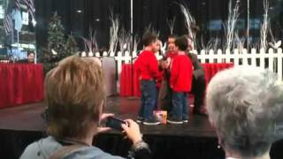 adorable quadruplets kids sing jingle bells at indianapolis christmas gift and hobby show