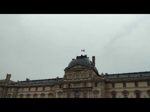 French Flag Flying Above the Louvre Palace