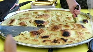 Italy Street Food. Cooking The Farinata Dish. Turin Street Food Parade