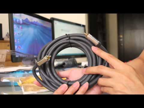 Unboxing subwoofer and optical cable for home theater