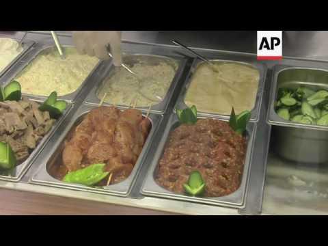 Restaurant businesses provide lifeline for Syrian refugees