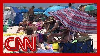 CNN reporter debunks Alabama beachgoers' Covid 19 theories