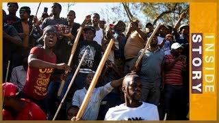 Whats behind South Africas violence against foreigners  Inside Story