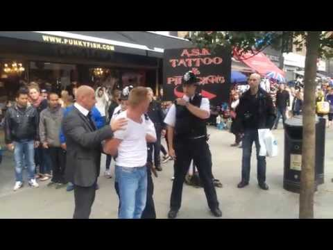 Guy getting arrested for assault in Camden town