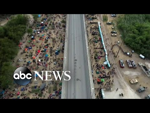 US begins to deport migrants, many of them Haitians