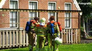 Brand in grasmaaier slaat over naar woning