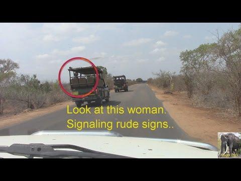 Rude Woman Tourist In Safari Vehicle