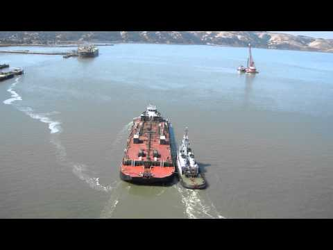Tugs working together to move a tank barge