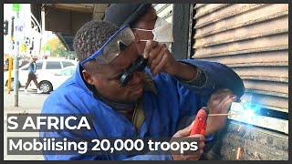 South Africa deploys more than 20,000 troops as death toll tops 100
