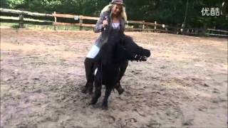 Woman rides tiny pony