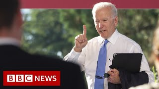 Biden lashes out at CNN reporter over Putin comments - BBC News