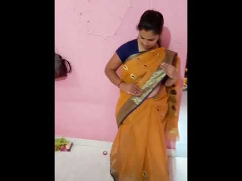 Cute aunty striping saree- then wearing saree- y navel show.