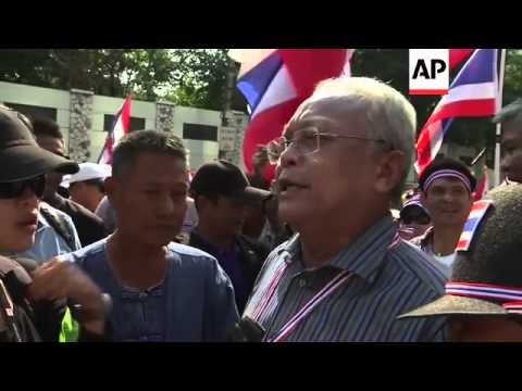 Anti-government protesters march through Bangkok
