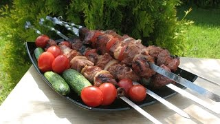 Barbecue for 40 minutes. Tomato marinade for barbecue. Vegetables on the grill.
