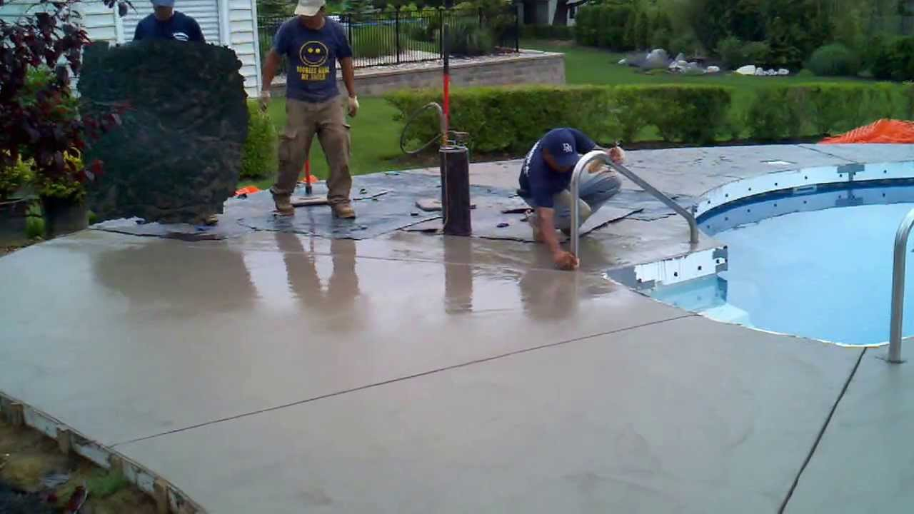 Textured Concrete Being Installed Around A Cantilever Edge Pool