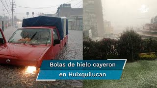 A bordo de camionetas, los policías estatales intentaron auxiliar a automovilistas que quedaron atrapados en calles que parecían ríos