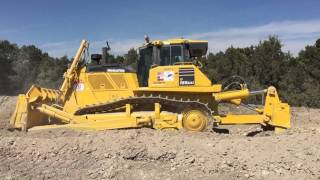 Komatsu D155 AXi ripping and loading scrapers