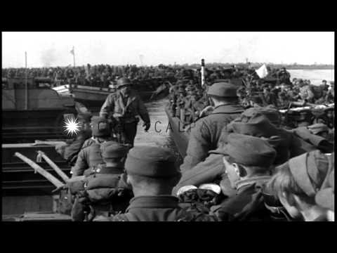 Huge barges on the Elbe River loaded with German soldiers waiting to disembark on...HD Stock Footage