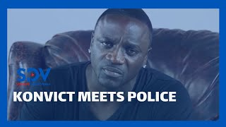 American singer Akon takes selfies with Police officer who is also a fan.