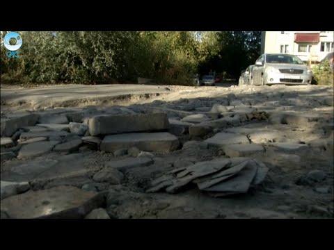 Жители улицы Кропоткина в Новосибирске жалуются на ужасное состояние выезда из жилого массива